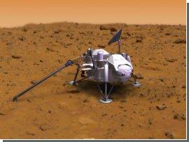 """""""Фенікс"""" збирає марсіанський грунт для аналізу. Фото"""